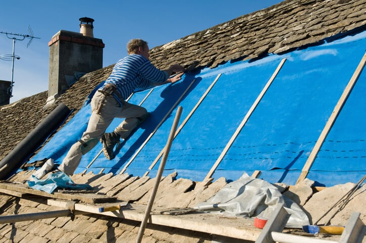 workers installing roofing